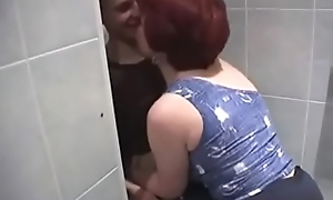 Russian Old woman and lass in go to the loo