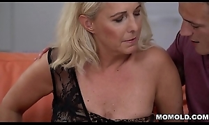 Blonde mature and her young suitor